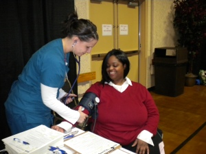 A Peninsula Regional staff member performs a blood pressure check at the Eastern Shore Mission of Mercy on Friday, March 15.