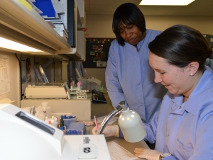 Farin Phillips, left, a Salisbury University student in the Medical Laboratory Science Program, works with Ty Cornish of Peninsula Regional Medical Center in the PRMC lab.