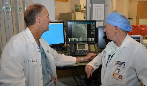 Dr. Steven Hearne, left, and Dr. Jeffrey Etherton examine a patient's vein image in the Guerrieri Heart & Vascular Institute's Cardiac Catheterization lab at Peninsula Regional Medical Center in Salisbury.