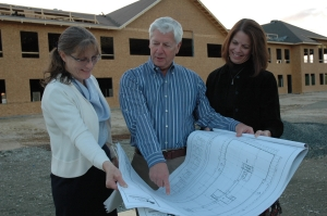 nancy Squires, MD, left, and Lisa Hohl, family nurse practitioner, review the Delmarva Health Pavilion plans with developer Palmer Gillis.