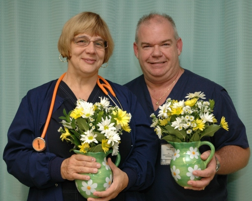 Robin Morrison, RN, and Dave Stroud, RN, of Peninsula Regional Medical Center's Emergency Department, were honored for their care of an infant and their compassion to her family.