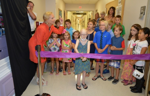 Brooke Mulford, 9, cuts the ribbon on Brooke's Toy Closet, from which children in the hospital can receive a toy to brighten their stay, along with her classmates from Salisbury Christian School, and Denise Billing, President of the Peninsula Regional Medical Center Foundation.