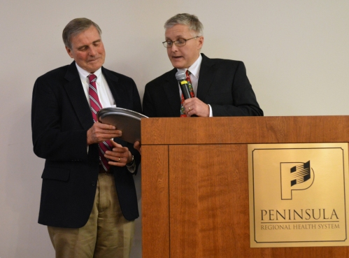 Salisbury cardiologist Dr. Donald Wood, left, is presented with a silver plate that proclaims him a recipient of the George W. Todd Memorial Award, in honor of the founder of Peninsula Regional Medical Center. Presenting the plate is William Todd, MD, a great-grandson of George Todd.