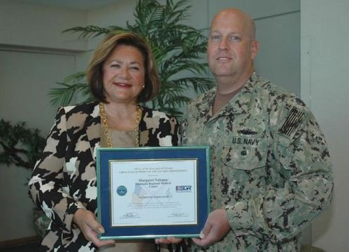 In the photo, Dr. Peggy Naleppa, MS, MBA, FACHE, President/CEO of Peninsula Regional Medical Center, and Tim Ward, RN and US Navy Reservist, display the Patriot Award presented recently to PRMC.