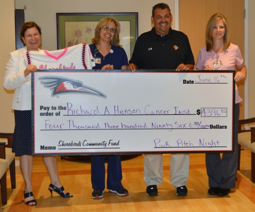 From left, Joan Daugherty, Executive Director of the Richard A. Henson Cancer Institute; Kathy Foxwell, Breast Center Nurse Navigator; Jimmy Sweet, Assistant General Manager of the Delmarva Shorebirds; and  Tina Hovis, Supervisor of the Breast Center.