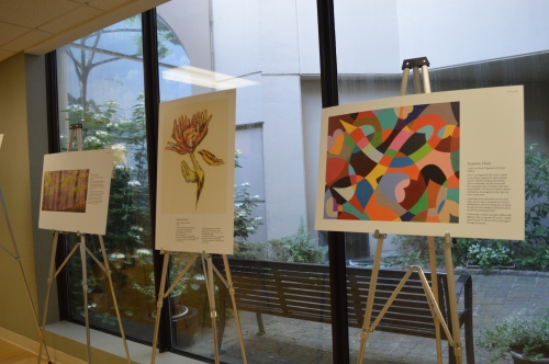 Artwork from the Oncology on Canvas show on exhibit in the RIchard A. Henson Cancer Institute.