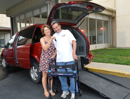 Mary Cannon and Gene Donofrio in front of the donated van.